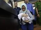 Vụ TrustBank: Nữ bị cáo mang con thơ tới tòa có vai trò gì?