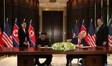 Vì sao ông Kim dùng bút của em gái để ký thỏa thuận chung?