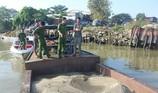 Lợi dụng mọi người mừng chiến thắng hút trộm cát sông Đồng Nai