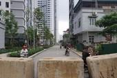 Phá rào chắn ở đoạn đường 2 chung cư đang tranh chấp