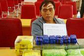 Thầy giáo mang súng vận chuyển 20 bánh heroin để lấy 200 USD