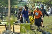 Indonesia đào hố chôn tập thể 300 nạn nhân động đất-sóng thần