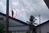 Thanh niên nghi ngáo đá, cố thủ 10 tiếng trên nóc nhà