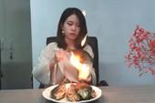 Clip: 'Thánh nữ công sở' nướng cá trên tay bốc lửa