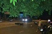 Tông xe máy ngã ra đường, 2 người bị xe tải cán tử vong
