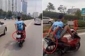 Vụ lái xe máy bằng chân: Công an mời chủ xe làm việc