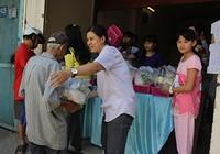 In phiếu giả để lãnh quà Tết của người nghèo