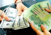 NHNN tăng tỉ giá liên ngân hàng 1%, nới biên độ tỉ giá 3%