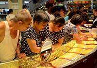 Trung Quốc: Nhân dân tệ mất giá vẫn không 'khát vàng'?