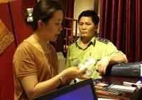 Bắt quả tang cửa hàng giao dịch bằng tiền Trung Quốc