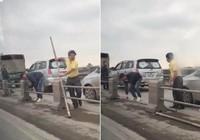 Đi sai làn, tài xế ô tô tháo cả dải phân cách để thoát