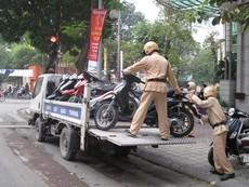 Xe vi phạm bị CSGT tạm giữ, hư hỏng ai bồi thường?
