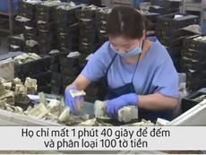 Nữ nhân viên đếm tiền nhanh như máy ở Trung Quốc