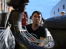 Ba anh em cứu hộ xe máy bị ngập miễn phí ở TP.HCM