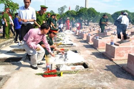 Lễ tiếp nhận, truy điệu hài cốt 26 liệt sỹ hi sinh tại chiến trường Lào - ảnh 6