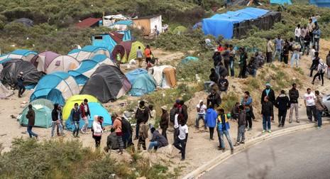 Putin: 'Mỹ đứng đằng sau khủng hoảng di cư của châu Âu' - ảnh 1