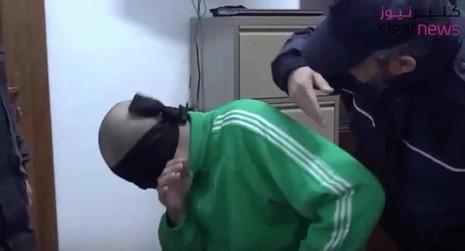 Con trai của Gaddafi bị tra tấn trong tù - ảnh 1