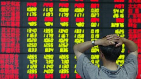 Trung Quốc bắt nhà báo 'đưa tin thất thiệt' khiến chứng khoán rớt giá - ảnh 1
