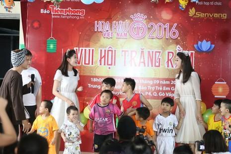 Tân hoa hậu, á hậu đàn hát vui Trung thu với trẻ bất hạnh     - ảnh 22