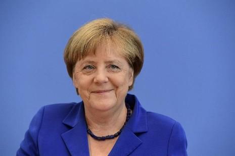 Đức sẽ không quay lưng với người tị nạn, Thủ tướng Đức Merkel khẳng định trong cuộc họp báo ngày 28-7.