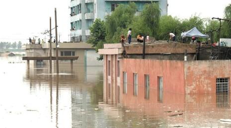 Hình ảnh lũ lụt ở Triều Tiên do hãng tin KCNA cung cấp.