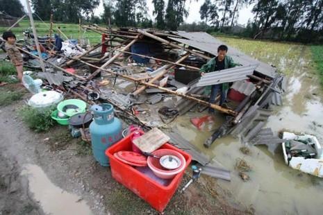 Nhà sập ở huyện Tuyền Châu tỉnh Phúc Kiến (Trung Quốc) ngập lụt sau khi hứng siêu bão Meranti.