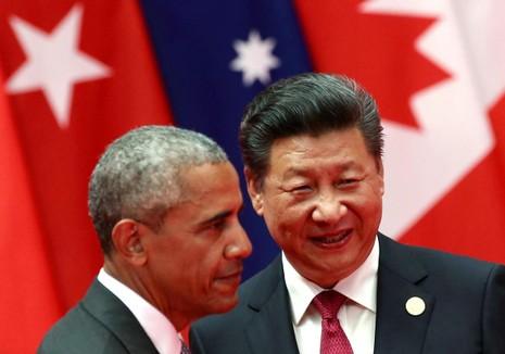 Chủ tịch Trung Quốc Tập Cận Bình (phải) trong một cuộc gặp với Tổng thống Mỹ Barack Obama.