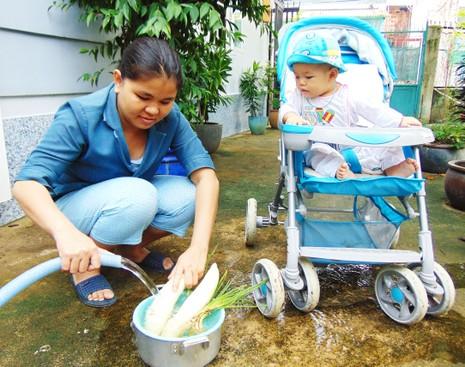 100% hộ dân quận 12 được sử dụng nước sạch - ảnh 1