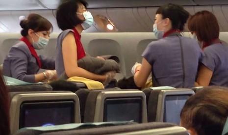 Cố ý sinh con trên máy bay đến Mỹ phải bồi thường 720 triệu đồng - ảnh 1