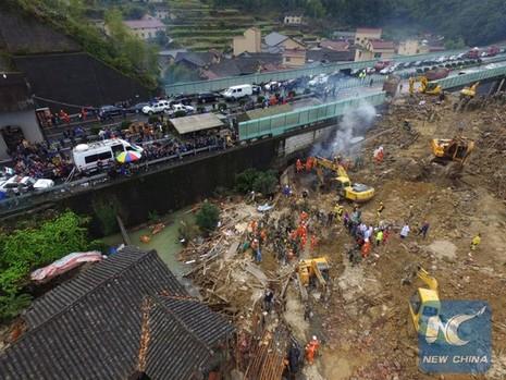 Trung Quốc: Sạt lở đất, bốn người chết, 33 người mất tích - ảnh 2