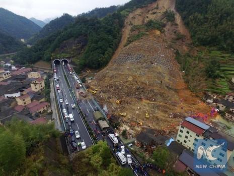 Trung Quốc: Sạt lở đất, bốn người chết, 33 người mất tích - ảnh 3