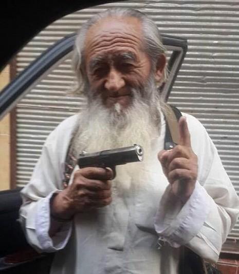 IS tung ảnh 'lão chiến binh' người Trung Quốc - ảnh 1