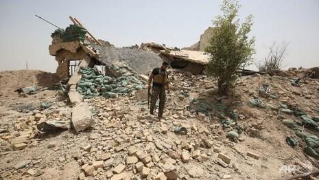 Phát hiện mộ tập thể kinh hoàng, chôn 400 người ở Iraq - ảnh 1