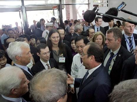 Tổng thống Pháp kết thúc 1 ngày thăm và làm việc tại TP.HCM - ảnh 12