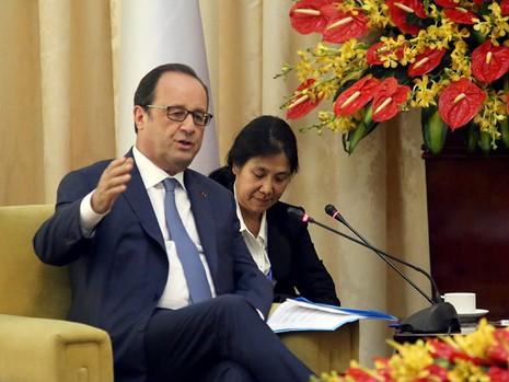 Tổng thống Pháp kết thúc 1 ngày thăm và làm việc tại TP.HCM - ảnh 17
