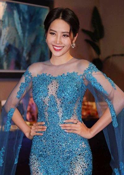 Đại diện Việt Nam mặc váy đuôi cá xuyên thấu của nhà thiết kế Hằng Nguyễn. Ảnh VNE