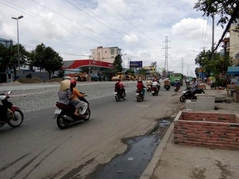 Nâng đường Kinh Dương Vương, 90% nhà dân bị trũng thấp - ảnh 2