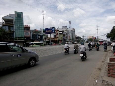Nâng đường Kinh Dương Vương, 90% nhà dân bị trũng thấp - ảnh 1