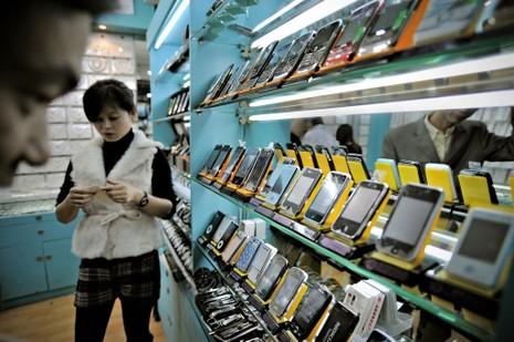 Trung Quốc phá đường dây 41.000 iPhone giả - ảnh 1
