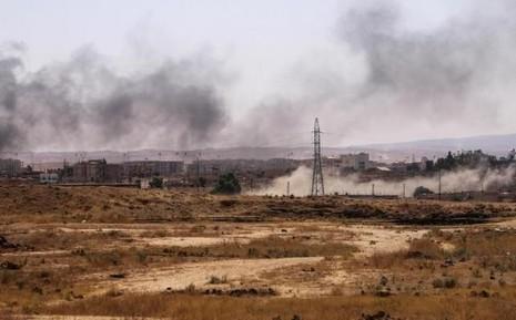 Lực lượng IS lâm vào thế khó, 'lưỡng bề thọ địch' - ảnh 1