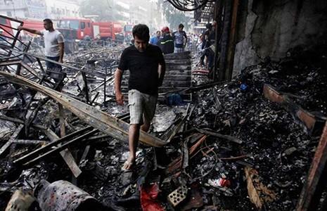 Đánh bom đẫm máu ở thủ đô Iraq, 75 người chết - ảnh 1