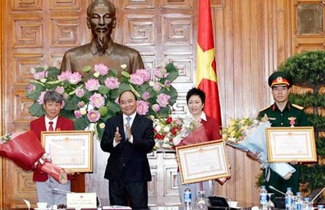 Thủ tướng trao huân chương Lao động hạng Nhất cho VĐV Hoàng Xuân Vinh - ảnh 1