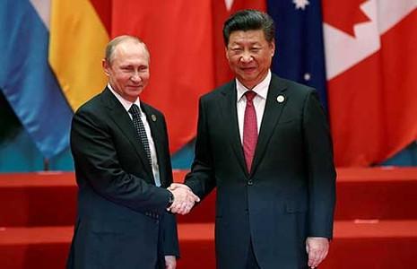 Trung Quốc-Nga lập liên minh quân sự  - ảnh 1