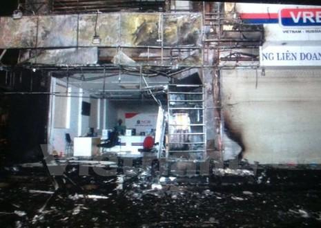 Cháy tòa nhà chi nhánh Ngân hàng Thương mại cổ phần Quốc Dân  - ảnh 1