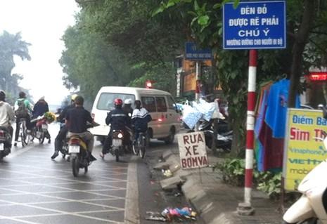 Đèn đỏ xe máy có được phép rẽ phải? - ảnh 1