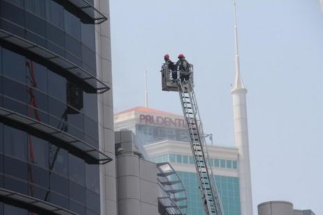 Diễn tập chữa cháy, cứu hộ trong tòa nhà 21 tầng - ảnh 12