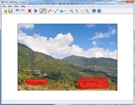 Tảng đá và thông tin ngày giờ chụp ở file ảnh gốc (trên) đã bị loại bỏ nhờ InPaint