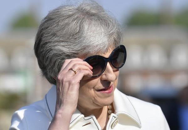 Anh và Thủ tướng Theresa May đến hội nghị G7 lần này với tâm thế thân thiện và hòa giải. Ảnh: EPA
