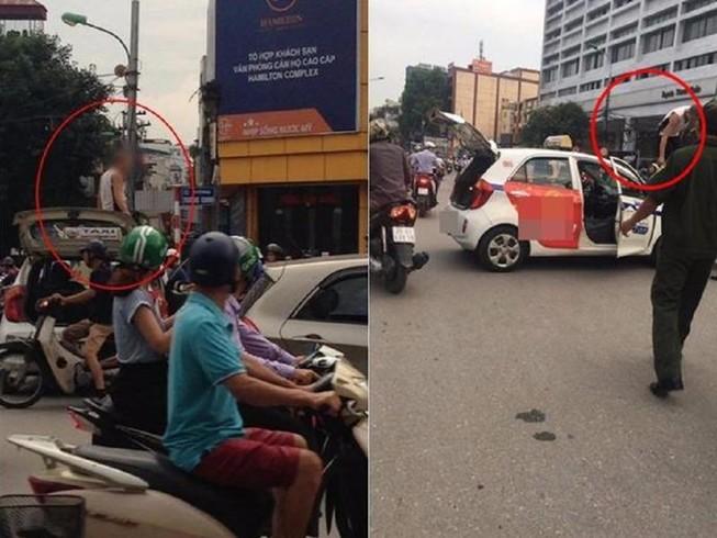 Bị dừng xe, tài xế taxi leo lên nóc 'ăn vạ'
