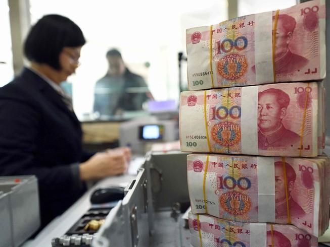 Trung Quốc hạ giá nhân dân tệ để đối phó Mỹ